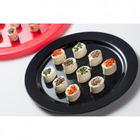 Disposable plastic and rounded black dish for catering